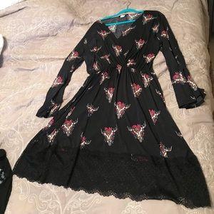Black long sleeve dress with cow skulls